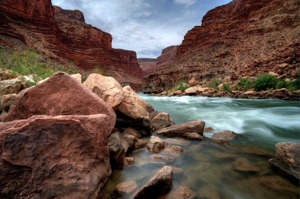 The Colorado river flows through the Grand Canyon.